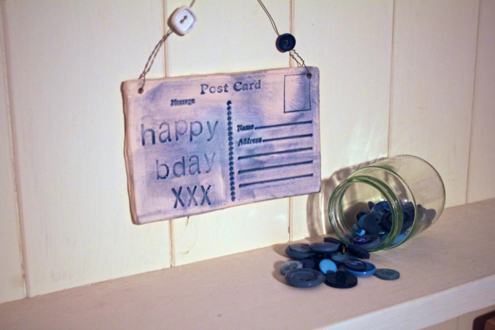 Ceramic Birthday Postcard. Lightly glazed in blue. Handmade made in Wales, UK